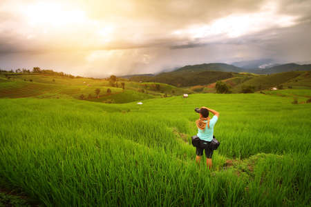beautiful location: Beautiful landscape during sunset of the rice terraces(paddy field) and mountains at Mae-Jam , Chaingmai in Thailand is a beautiful location and very popular for photographers and tourists
