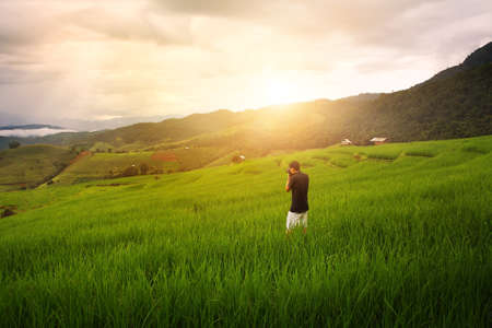 Tourists are photographing the natural beautiful  of the rice terraces(paddy field) and mountains at Mae-Jam , Chaingmai in Thailand is a beautiful location and very popular for photographers and tourists
