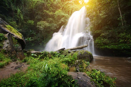 beautiful location: Beautiful natural of Pha Dokseaw Waterfall at  Chiang Mai province in Thailand , is a beautiful location and very popular for photographers and tourists. Traveling and recreation Concept