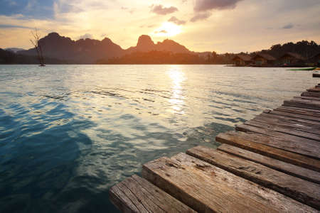 Beautiful scenery during sunset of lake river at natural attractions in Ratchaprapha Dam at Khao Sok National Park, Surat Thani Province in Thailand. Traveling and recreation Concept