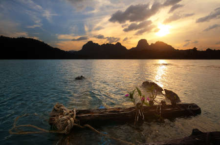 Silhouette scenery during sunset of lake river at natural attractions in Ratchaprapha Dam at Khao Sok National Park, Surat Thani Province in Thailand. Traveling and recreation Concept Stock Photo