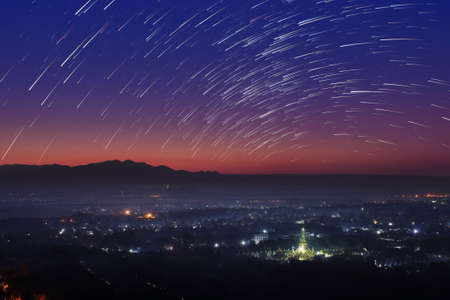 beautiful location: Beautiful scenery during the twilight before the sun rise and star trail of top view at Mandalay hill in Myanmar. is a beautiful location and very popular for tourists and photographer