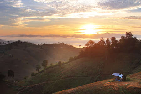 Beautiful scenery during sunrise with the mist at Ban Huay Kon ,Chaloem Phra Kiat district ,Nan province in Thailand is a very popular for photographer and tourists. Attractions and natural Concept
