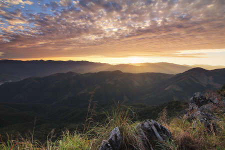 Beautiful scenery during time the sunset view from top of Doi Pha Phung at Nan province in Thailand is a very popular for photographers and tourists. Attractions and natural Concept