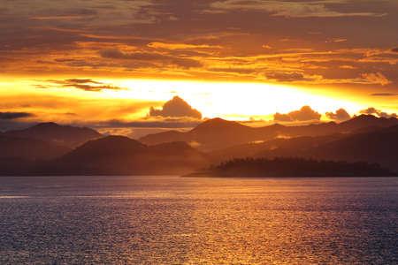 Natural background of colorful sky and mountain during sunset at Kaeng Krachan Dam, Kaengkrachan National Park ,Petcahburi  in Thailand. Attractions and natural Concept.