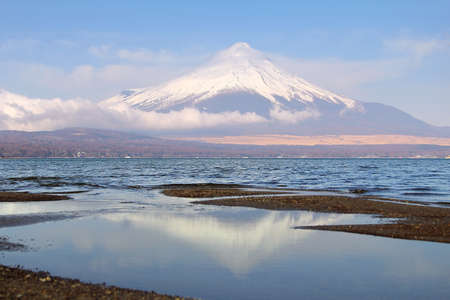 Beautiful scenery of Mountain Fuji with reflection on the lake Yamanakako in japan. This is a very popular for photographers and tourists. Travel and Attraction Concept