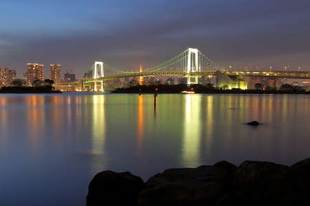 Beautiful scenery during  night time at Tokyo Waterfront night view Rainbow Bridge in Japan. This landmark is a very popular for photographers and tourists. Travel and transportation Concept Stock Photo