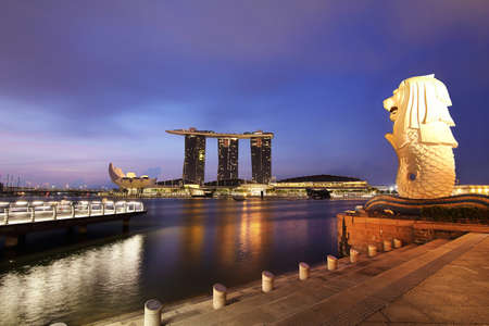 Singapore - July 30, 2017: The Mer lion fountain and marina bay sands during twilight time is famous landmark and very popular for photographers and tourists of Singapore city