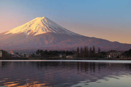 Beautiful scenery during sunrise at Mountain Fuji in kawaguchiko lake of Japan. This is a very popular for photographers and tourists. Travel and Attraction Concept Stock Photo