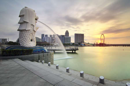 Singapore - July 30, 2017: The Mer lion fountain and marina bay sands during sunrise is famous landmark and very popular for photographers and tourists of Singapore city Editorial