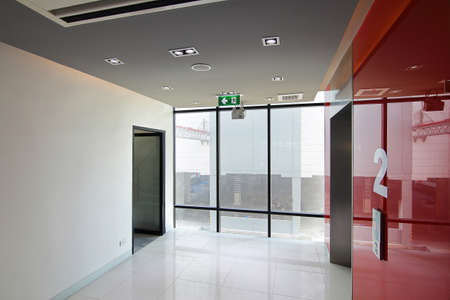 Elevator on second floor and emergency exit of the building with fire exit sign