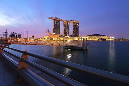 Singapore - July 30, 2017: Marina bay sand of Singapore during twilight before sunrise is famous landmark and very popular for photographers and tourists of Singapore city