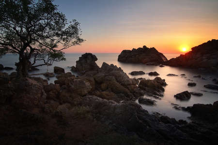 Silhouette beautiful scenery during sunset of Kung Wiman Beach at Chanthaburi province in Thailand. This is very popular for photographers and tourists. Travel and natural Concept