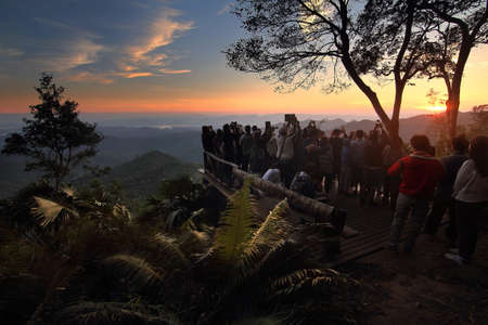 Many tourists watching the sunrise and take photos at view point of