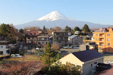 Mountain Fuji and clear sky among the residential community at yamanashi in Japan.This is a very popular for photographers and tourists. Travel and Attraction Concept Stock Photo