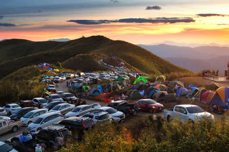 Thailand - December 30,2017 : Many cars of tourists come camping and lets see beautiful of natural and during sunset in long weekend at Nern Chang Suek Mountain, Kanchanaburi province in Thailand.