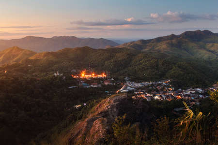 Beautiful scenery during sunset at Nern Chang Suek Mountain and the village in the middle of the valley at Pilok, Kanchanaburi province in Thailand. Attractions and natural Concept