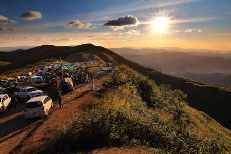 Thailand - December 30,2017 : Many cars of tourists come camping and let's see beautiful of natural and during sunset in long weekend at Nern Chang Suek Mountain, Kanchanaburi province in Thailand.