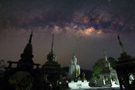 Milky way and many stars on night sky at Temple in Thailand