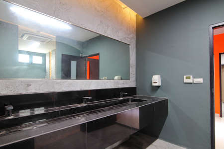 Sinks inside the public toilet,public bathroom. They are not clean and dusty