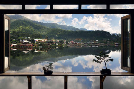 Beautiful scenery of nature with water reflection outside the window at Lee wine ruk thai Lake, Mae Hong Son in Thailand. Freedom and natural Concept Stock Photo