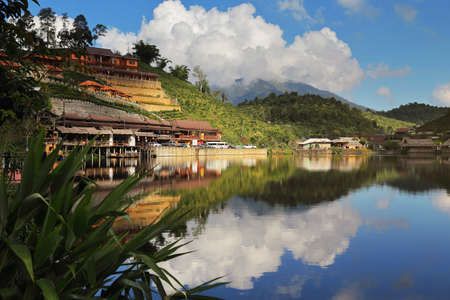 Beautiful scenery of water reflection at the Chinese village at the Lee wine ruk thai lake, Mae Hong Son in Thailand is a very popular for photographers and tourists Stock Photo