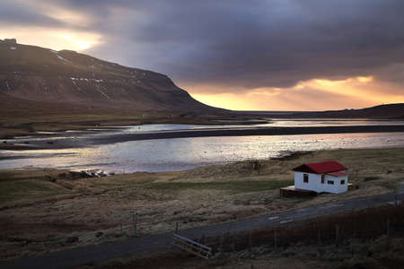 Beautiful scenery of natural from meadow and mountains during sunset in Iceland.