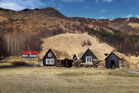 Beautiful scenery of natural and traditional Icelandic houses at Skogar in Iceland Editorial