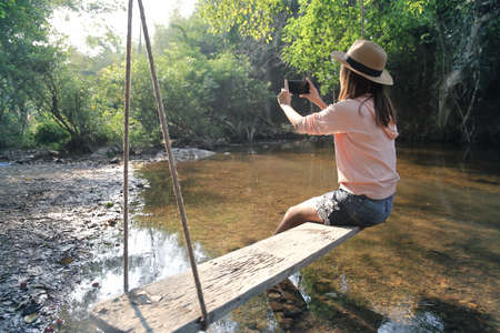 Female tourists sit and rest among beautiful nature park. Relaxation and travel concept