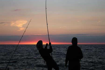 pescador: Pescadores en la salida del sol