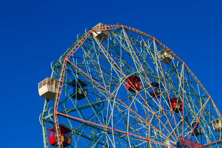 is cloudless: Wonder Wheel in Coney Island against blue cloudless sky. Photographed in September 2015. Stock Photo