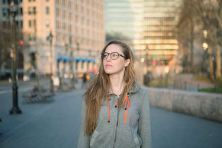 geeky: Hipster girl in casual clothing photographed in NYC in April 2016.