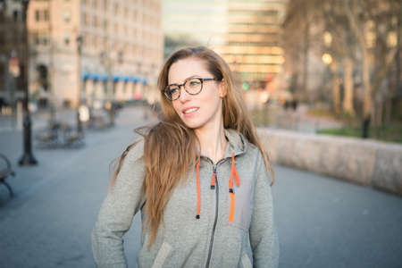Hipster girl in casual clothing photographed in NYC in April 2016.