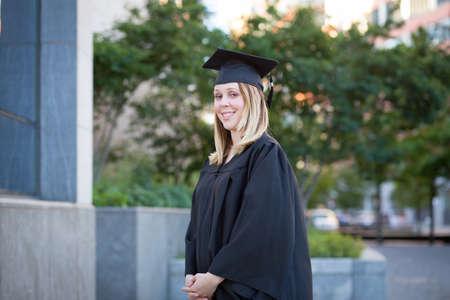 undergraduate: Portrait of female college student on campus in graduation day