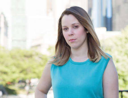 blonde hispanic: Portrait of business woman in business district Stock Photo