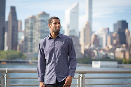 Portrait of young handsome African American man with NYC skyline in the photographed in September 2017 Stock Photo