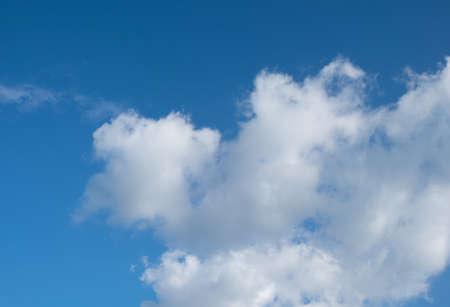 brighten: blue sky background with white clouds, brighten day