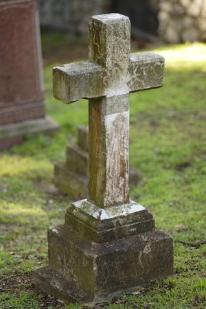 ceased: Nameles cross shaped gravestone in a cemetery