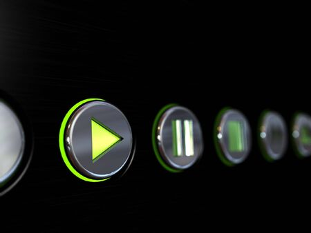 Media player buttons on a brushed metal surface with the play button glowing as if turned on photo