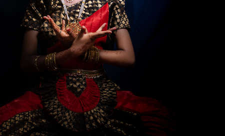 An indian dance form Bharatnatyam pose given by a girl
