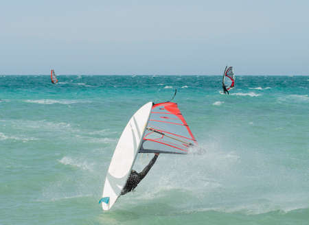 windsurfer athlete performing extreme windsurfing tricks and jumps in Anapa Krasnodar Region, Russia