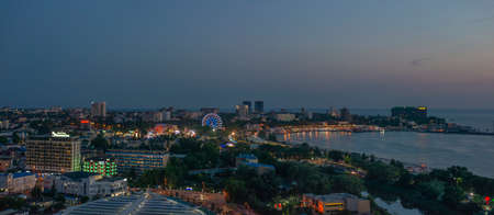Beautiful night view of coastal city Anapa with river flowing into the sea on the sunset. 版權商用圖片