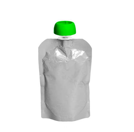 White empty plastic doy pack with spout and round green lid, for baby food, fruit puree, snack on the go, isolated on a white background