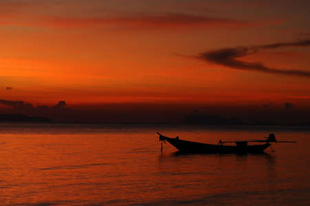 Sunset over sea with boat