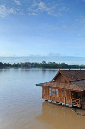 Riverside houseboat, Thailand