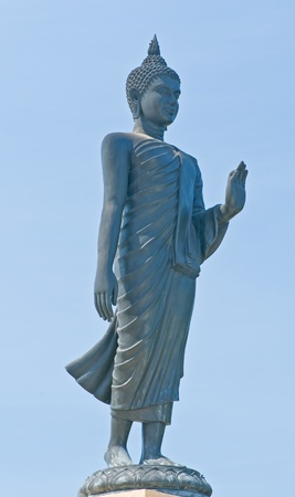 Buddha statue against blue sky photo
