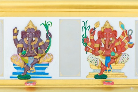 Ganesha carving on temple wall, Thailand  photo