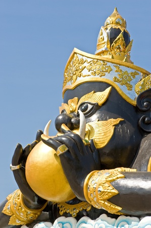 Statue of black deity called Rahu and blue sky background Stock Photo - 11532190