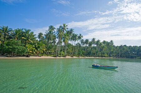 Boat near tropical beach in Kut island, Thailand
