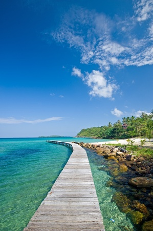 Wooden footbridge along the beach of Kut island, Thailand